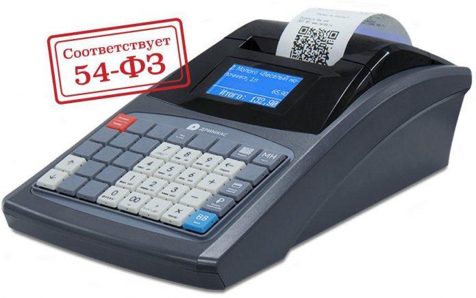 Кассовый аппарат и штамп «Соответствует 54-ФЗ»