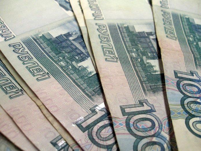 Купюры по одной тысяче рублей